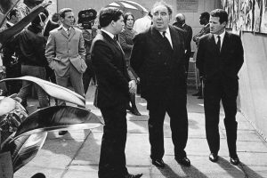 Exhibition of Biafra Mounted by The Spectator Magazine, London 1969, In front: editor of The Spectator Magazine Nigel Lawson (later Baron Lawson Chancellor of the Excequer in the Tatcher government), Chairman of the Arts Council of Great Britain Lord Goodman and Romano Cagnoni. On the background: Frederick Forsyth and Berenice Sydney Cagnoni
